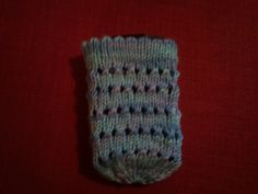 Holey Phone Sock by Lorayne Dawson.   Again I was playing around with patterns to try and make something pretty.