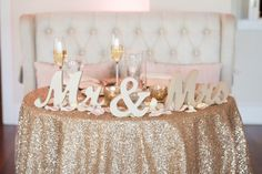 gold sparkle wedding tablecloth, mr and mrs sign, sweetheart table reception, furniture reception from The Oaks Waterfront Inn Maryland Glam vintage Wedding by Mike B Photography