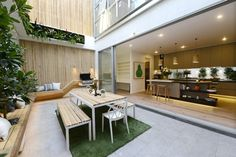 Outdoor terrace l Astro turf l Hanging vertical garden l Wrap around bench seating #theblock #stylecurator
