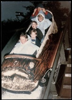 Diana, Prince William and Prince Harry at a theme park