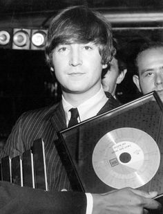 John Lennon holding twist and shout..