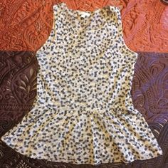 Dark green and cream peplum top Dark green and tank dotted design. Peplum style. Is mesh material. As long as it's worn with a nude or white bra it does not require layering. New York & Company Tops Tank Tops
