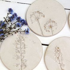 Beautiful and totally unique ceramic coasters, made by pressing wild flowers into clay. Glazed in a neutral off white glaze.  A lovely house warming, wedding or birthday gift.  Price is for individuals but a set of four can also be bought. Please select from the drop down menu.