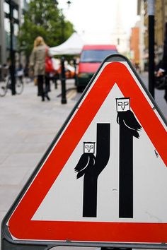Birds on a street sign in London