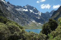 Glimpse of Lake Marian in front of Mt Crosscut - Fiordland National Park - Wikipedia Small Island, New Age, New Zealand, Beautiful Places, National Parks, Australia, Mountains, Forests, Travel