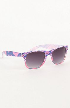These sunglasses combine the classic Ray-ban shape with a tribal print  pattern to make f89827f321c3