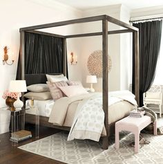 Deep charcoal and shades of elegant blush turn this bedroom into a pretty space that's soft but dramatic.