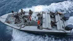 Iran's Navy marines try to board a hijacked vessel heading for Iran in the Indian Ocean, March 30, 2012.