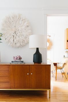 Our designer Heidi's SF home is the perfect mix of high and low, old and new, casual and fancy. Color and texture play a big part in this one bedroom. Hello giant African juju hat!
