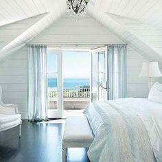 pale neutral bedroom by the ocean