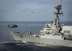 """170409-N-GD109-011  SOUTH CHINA SEA (April 9, 2017) An MH-60S Sea Hawk helicopter assigned to the  """"Black Knights""""  of Helicopter Sea Combat Squadron (HSC) 4 approaches the Arleigh Burke-class guided-missile destroyer USS Wayne E. Meyer (DDG 108). The Carl Vinson Carrier Strike Group is on a scheduled western Pacific deployment as part of the U.S. Pacific Fleet-led initiative to extend the command and control functions of U.S. 3rd Fleet. U.S Navy aircraft carrier strike groups have…"""