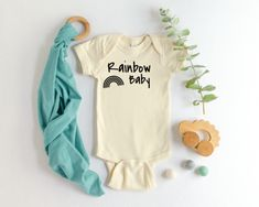 $16. Your little one is your HOPE after the storm in your life.  Let the world know that you held onto hope and that your hope, your dream, your amazing little love bug is here with you today by dressing them in this ultra soft, comfy, 100% preshrunk cotton #Rainbow Baby #onesie. Comes in one #natural earth tone that's perfect for both #baby boys and #baby girls! Click the link below to add this to your cart!