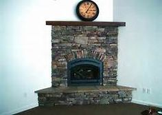 Simple design stone tile corner fireplace with inserts, like flat ...
