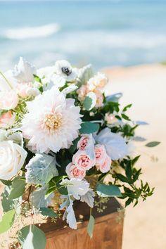 Blush & ivory Sunset Cliffs beach ceremony decor  by San Diego wedding florist, Compass Floral.