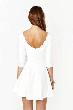 Scalloped back, white dress.