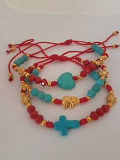 Arm Candy Red Bracelets, Red Cord Bracelets, Heart, Elephant and Cross Bracelets, Statement Cord Bracelets, Red and Turquoise Bracelets. Mother Gift, Statement Red Bracelets, Statement Trendy Bracelets. Arm Candy. Red Bracelets, Elephant, Cross and Heart Necklace, Red and Turquoise