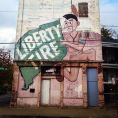 Old advertisement street art mural in Northside Cincinnati Ohio