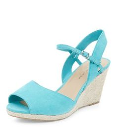 - Wide fit- Peeptoe front- Ankle strap fastening- Wedged heel height: 3