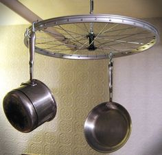 Rotating bike wheel pot rack. $100.00, via Etsy.  http://www.etsy.com/listing/52903022/rotating-bike-wheel-pot-rack#