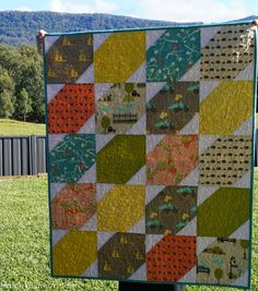 Learn how to quilt with pre-cuts in order to make a quick quilt with baby quilt patterns like the Bluebird Park Baby Quilt Pattern. Using 10 fat quarter fabric squares or 20 layer cake squares, this free quilting pattern is much easier to make than you think.