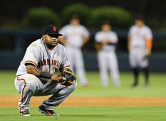 San Francisco Giants' Pablo Sandoval waits for the umpires as they watch a replay during the ninth inning of a baseball game against the Philadelphia Phillies on Monday, July 21, 2014, in Philadelphia. The Giants beat the Phillies 7-4. (AP Photo/Michael Perez)