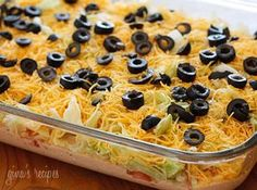 TACO DIP!   This is one of the best dips I've ever had! EASY: cream cheese, sour cream, taco seasoning, salsa, lettuce, cheese and olives/tomatoes!