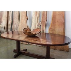DIMENSIONS 103″L x 49″W x 30″H x 3″ thick. Custom sizes available. COLORS Natural rosewood DESCRIPTION Gorgeous 3″ thick single slab of rich aged rosewood in an oval shape set on a dark stained modern teak base.