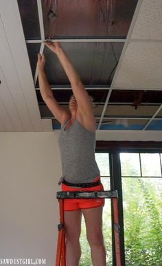 Installing WoodHaven Planks and Hiding Ugly Drop Ceiling Grid! - Sawdust Girl® Install plank ceilings ON a suspended, drop ceiling grid! Drop Ceiling Grid, Drop Ceiling Basement, Drop Ceiling Tiles, Drop Down Ceiling, Plank Ceiling, Dropped Ceiling, Ceiling Panels, Ceiling Decor, Ceiling Ideas