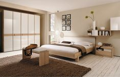 Contemporary Bedroom Benches Ideas Neutral Plain Beige Wall Modern Bedroom Design Solid Wood Platform Bed Natural Wooden White Leather Cushion End Of Bed Bench Dark Brown Fur Area Rug Laminated Glossy White Fronts Wooden Wardrobe Solid