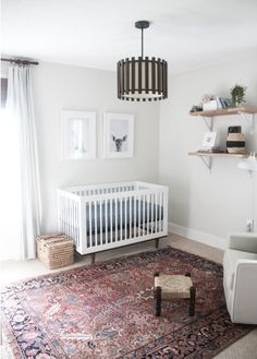IG User earnesthomeco_ loves how the blues and blushes in our Heriz Persian Rug tie together her chic gender-neutral nursery!