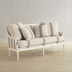 What's old is new again, and this Sheraton-style Parlor Settee from the Magnolia Home Collection by Joanna Gaines is built for today with sturdiness and comfort in its solid wood frame and thick cushions. Scaled to fit almost anywhere, it's finished with neoclassical trim.