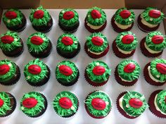 AFL Grand Final Day Cupcakes with Red Sherrin Footballs Amongst the Grass • by Baking Gorgeous | www.bakinggorgeous.com