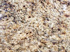 santa cecilia granite.  light almond/off-white coloring with streaks of blue, darker brown.