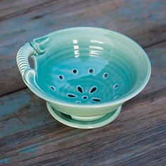 Take summer berries from sink to table with our Turquoise Pottery Berry Bowl. Rinse berries in the decorative bowl with drainage holes, while a small saucer dish catches excess water when you're ready to serve. Made in North Carolina by Beckett Pottery.