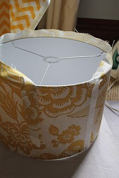 Recover a lamp shade Diy Home Repair, Upholstery Cleaner, Furniture Upholstery, Diy Furniture, Upholstery Trim, Lampshade Chandelier, Lampshades, Home Office Lighting, Bedroom Crafts