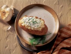 Combine and blend cottage cheese, yogurt and lemon juice. Fold in onions and dill. Cover and refrigerate until time of service. Serve each baked Idaho Potato with 2 oz. of topping (1/4 cup ladle)