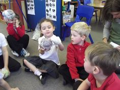 Pupils from Finstock Primary School make African footballs from plastic bags, having seen some on their 'First Visit to the Pitt Rivers Museum'!