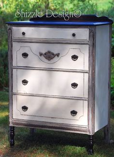 Shabby Chic Highboy refinished in old white chalk paint by Shizzle Design of West Michigan.  The top, legs and details were re-stained in a dark espresso finish.  This piece is currently available for purchase in my booth at Not So Shabby Antiques and Fine Furniture in downtown Zeeland, MI.  Check out more pictures of this renovation and see more of my designs at: http://alittlebitoshizzle.blogspot.com/2011/09/cuz-shes-got-personality.html