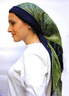 The butterfly is very popular in Jerusalem where women combine two different colored scarves to create a more sensational head piece. Two scarves also add body and height to your head. The butterfly can be worn with any two square scarves. This tie is especially nice when a fringed scarf is tied over an unfringed scarf.