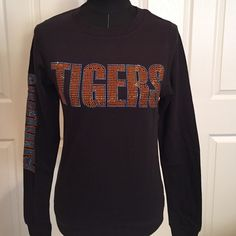 NWT. Auburn Tigers sweatshirt Love the bling on this Auburn Tigers lightweight black sweatshirt. Officially licensed collegiate product Tops Sweatshirts & Hoodies