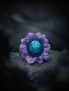 Chopard. Fleur d'Opales ring, 24.3ct black opal, tsavorites garnets-set pistils, petals set with purple sapphires and amethysts.