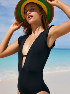 Sophia One Piece Swimsuit | Featuring a daring plunging neckline this one-piece swimsuit with a femme flutter sleeve. Canadian made.