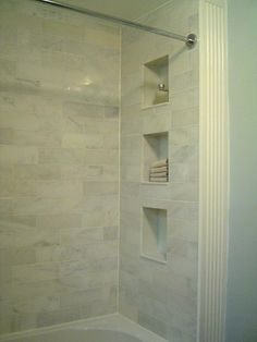 This tile might work in the guest/kids shower, although not all the way up. The built in cubbies I could take or leave