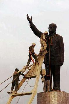 BAGHDAD, IRAQ - APRIL 9: (FILE PHOTO) U.S marines climb up to topple a statue of Iraqi dictator Saddam Hussein on April 9, 2003 at al-Fardous square in Baghdad, Iraq..