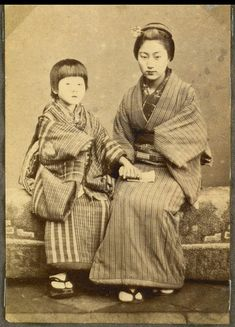 Japanese woman and a child, Japan.  Photograph from Nagasaki 1868.