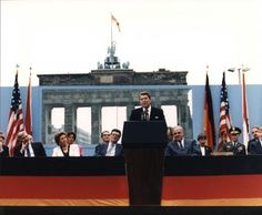 "June 12, 1987: At the Brandenburg Gate in Berlin, Germany, U.S. President Ronald Reagan publicly challenges Mikhail Gorbachev to tear down the Berlin Wall, using the phrase that would become famous: ""Mr. Gorbachev, tear down this wall."""