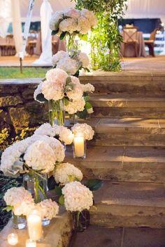 Reception stairwell lined with blooms - Deer Pearl Flowers / http://www.deerpearlflowers.com/wedding-ceremony-decor/reception-stairwell-lined-with-blooms/