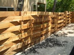 OH - the basket weave fence - love the style and simplicity.  Classic. I think this would look great around my patio in white. It would work so well with the age of my house. If you cant change it, celebrate it.