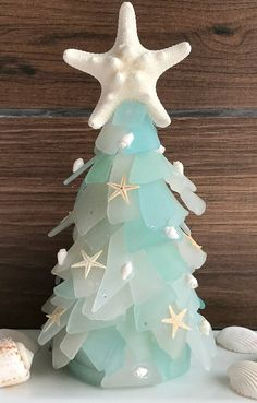 Coastal Christmas Decor Seaglass Christmas with Trees, Ornaments, Garlands and more. Featured on Completely Coastal. Coastal Christmas Decor, Nautical Christmas, Beach Christmas, Glass Christmas Tree, Holiday Tree, Christmas Holidays, Christmas Crafts, Christmas Decorations, Holiday Decor