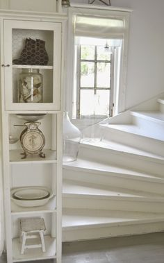 shabby chic white house, love the chicken wire cabinet with vintage things in it Cottage Living, Home Living, Cottage Style, White Staircase, Spiral Staircase, White Cottage, Cottage Interiors, White Rooms, Home And Deco